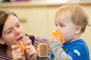 Fun with sand blocks at Kindermusik with Ali, music classes for toddlers in Haslemere