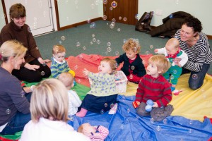 Baby Sensory play with bubbles at Kindermusik with Ali, baby music and movement classes in Haslemere, Surrey